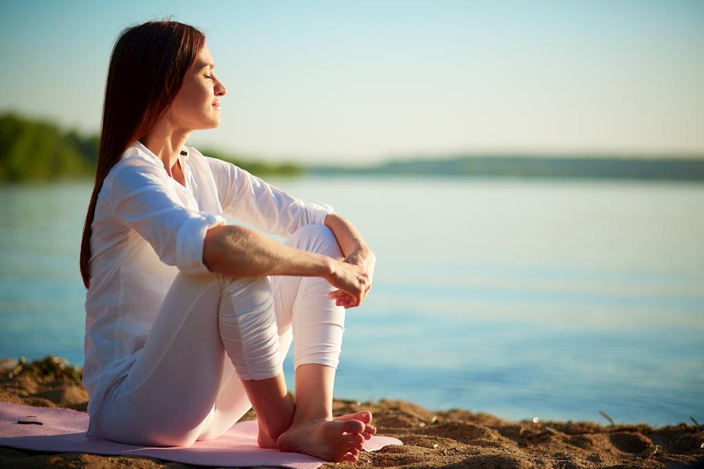 woman sitting near seaside