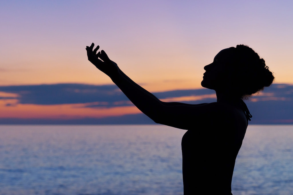 spiritual woman near sea